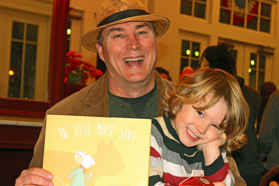 Author David E. Ray holds his new children's book, The Little Mouse Santi, as well as his main inspiration, his son Louis. Photo by David Lee Simmons with NOLA.com