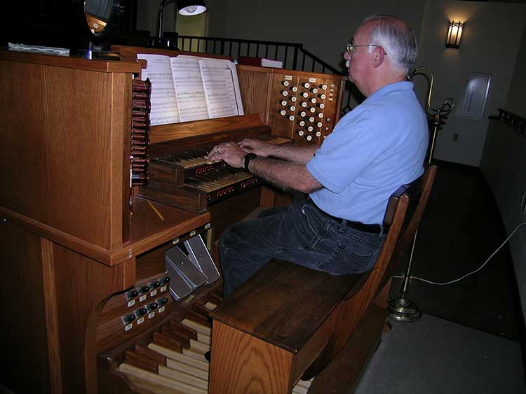 Louis Mayer playing a Golding and Woods pipe organ at First English Lutheran Church in Metairie.
