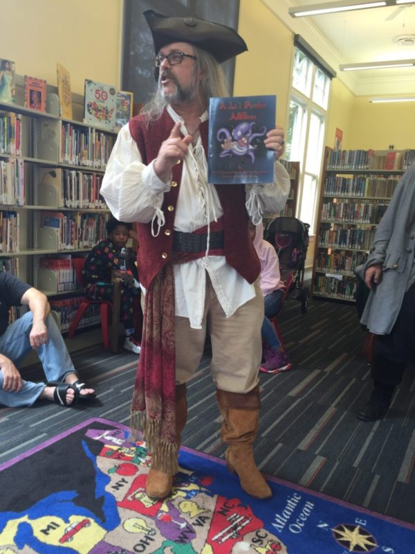 Ol' Chumbucket reads to kids at Hubbell Library in Algiers Point