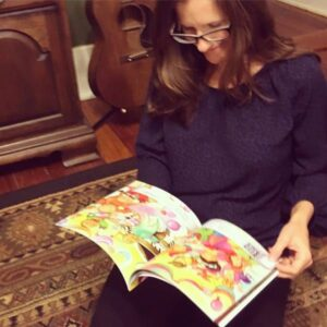 Katy reads the proof of her new children's book, Candy Land Ball