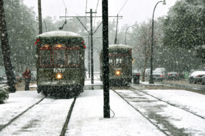 Snow falls over streetcars in New Orleans. Photo by Sally Asher.